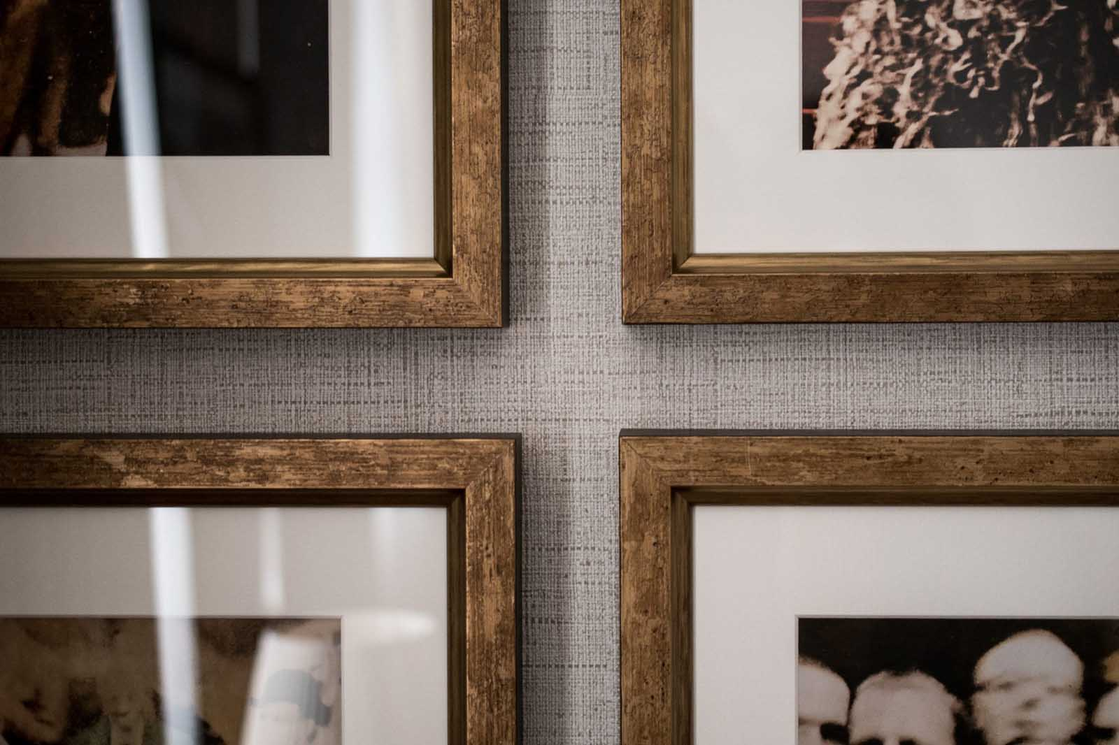 Four wooden picture frames hanging on a wall