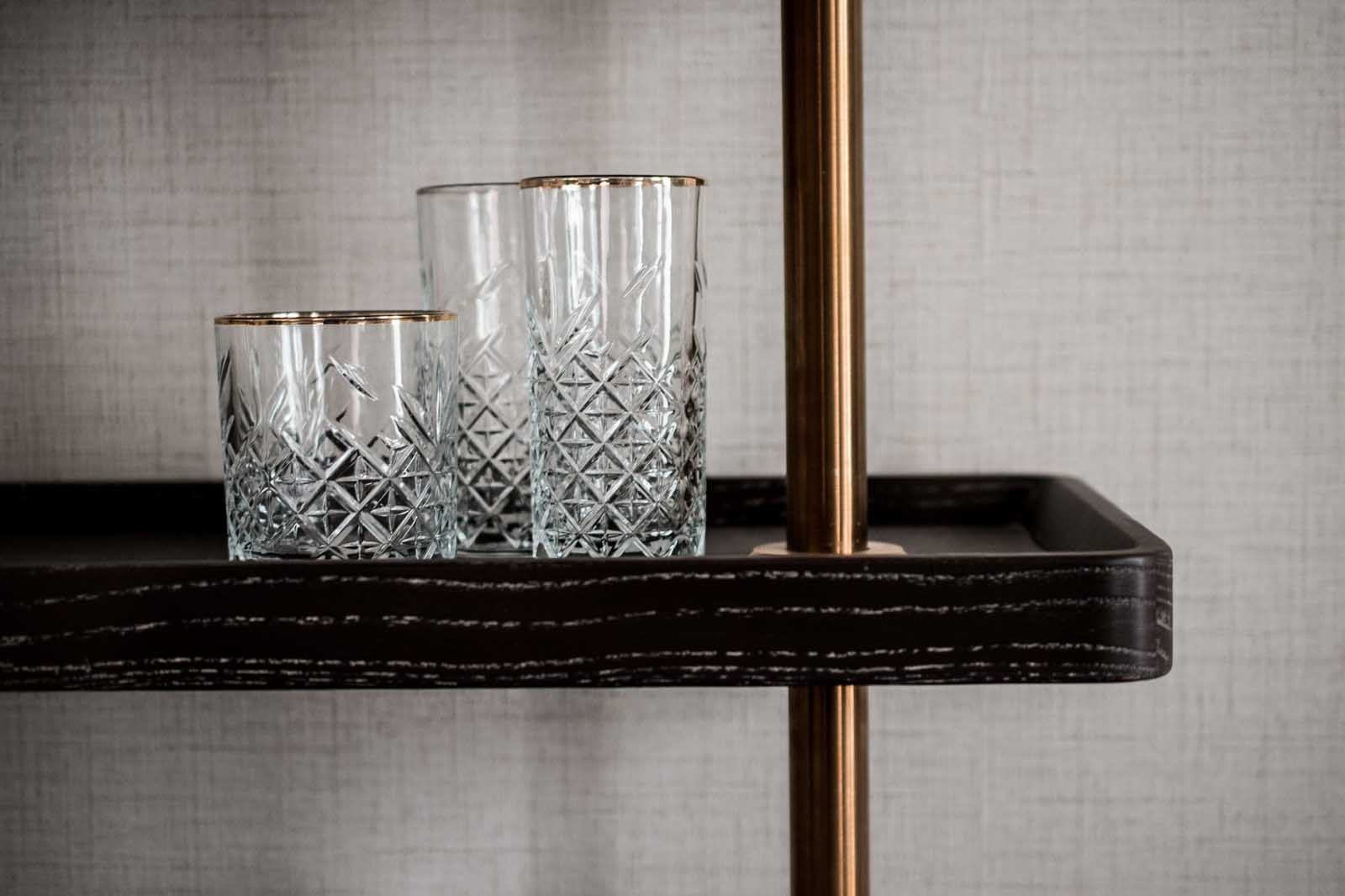 Three crystal glasses on a desk