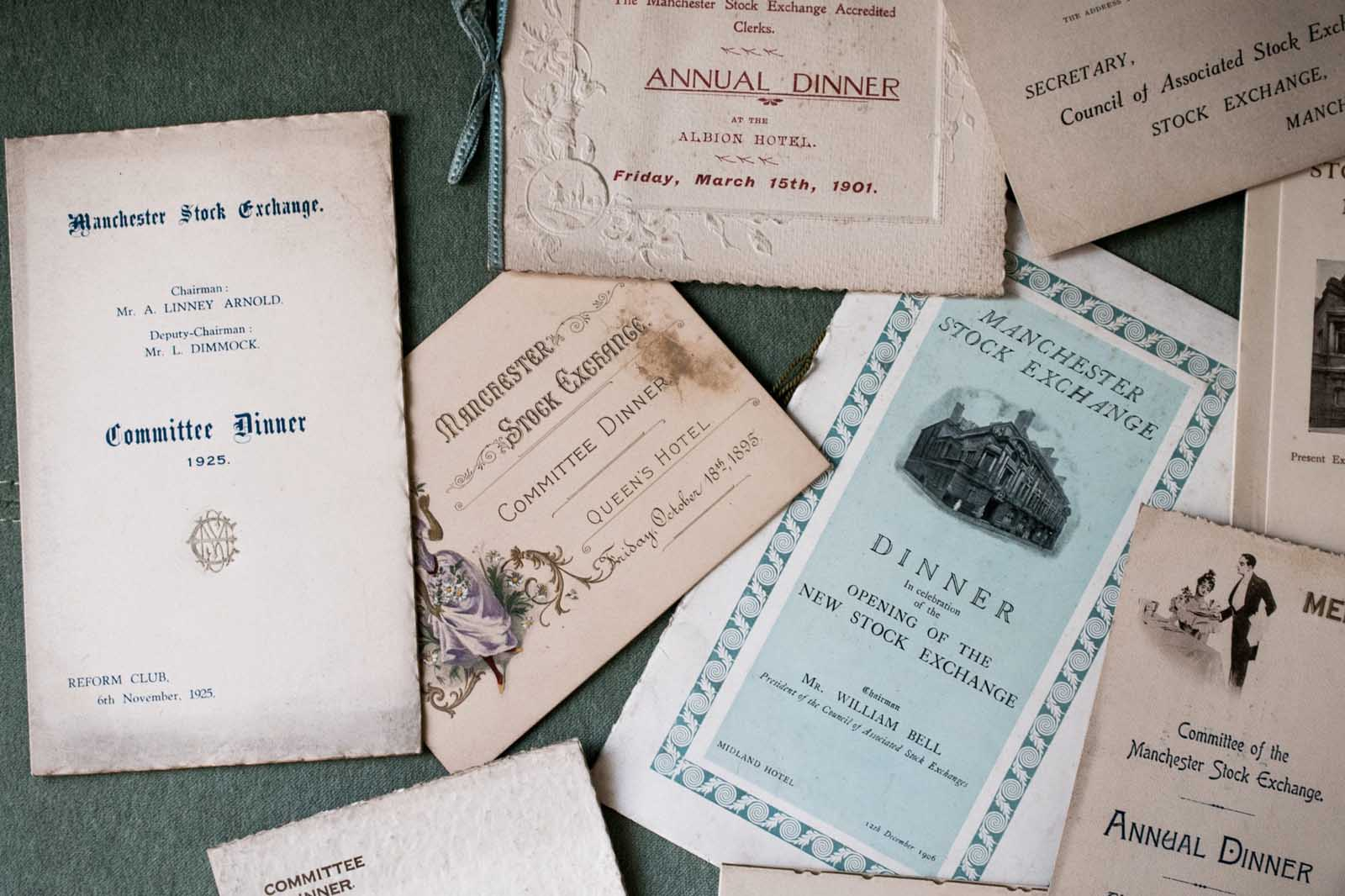 Image of a range of old invitations to events at The Stock Exchange