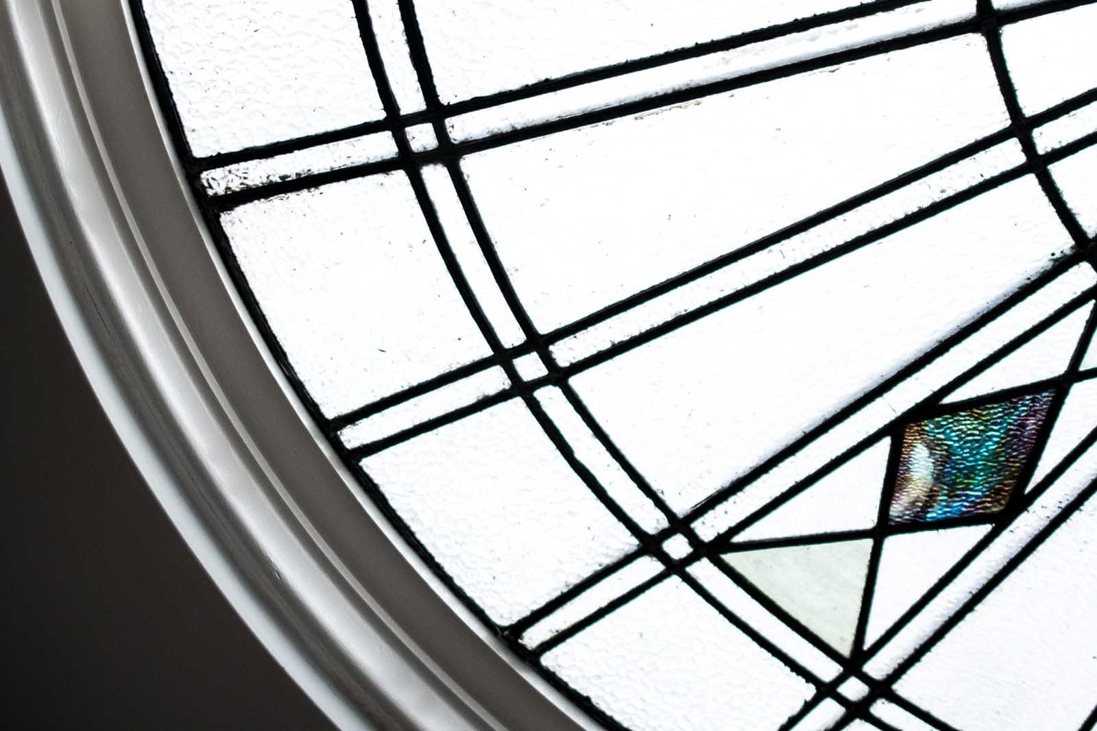 Part of a circular stain glass window